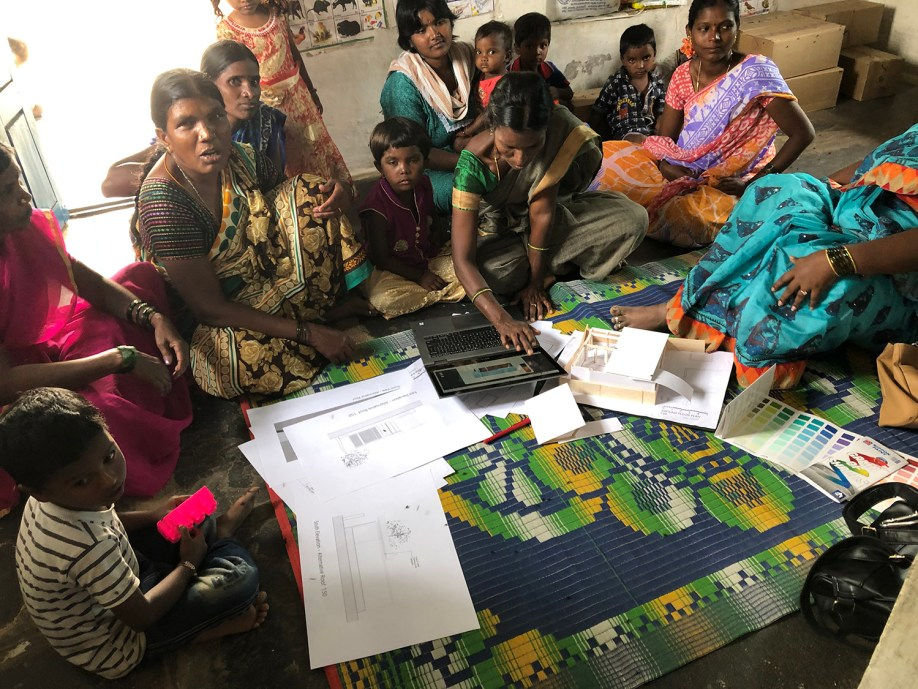 Formal Community Engagement Session with models, drawings, laptop and colour charts Source – Allison Stout, 2018