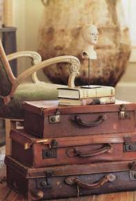 Old leather suitcases makes for an elegant and masculine living room side table | via http://www.apartmenttherapy.com/