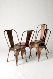 Love these copper finish industrial chairs from Anthropologie. Local La Grange Interiors has similar chairs | Image: http://www.anthropologie.com/