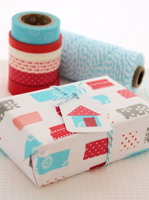 Lisa and Sarah over at A Spoonful of Sugar shared this gift wrapping idea. Love the idea of just using little strips of various washi tape designs | via http://www.aspoonfulofsugardesigns.com/2011/10/red-and-aqua-take-3.html