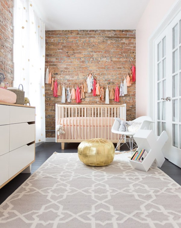 Adore this soft nursery - I think it's very tastefully done with hints of colour, texture and pattern. The fabric tassels against the rough brick wall creates a beautiful feature | via http://www.greylikesbaby.com/photography-2/10394/