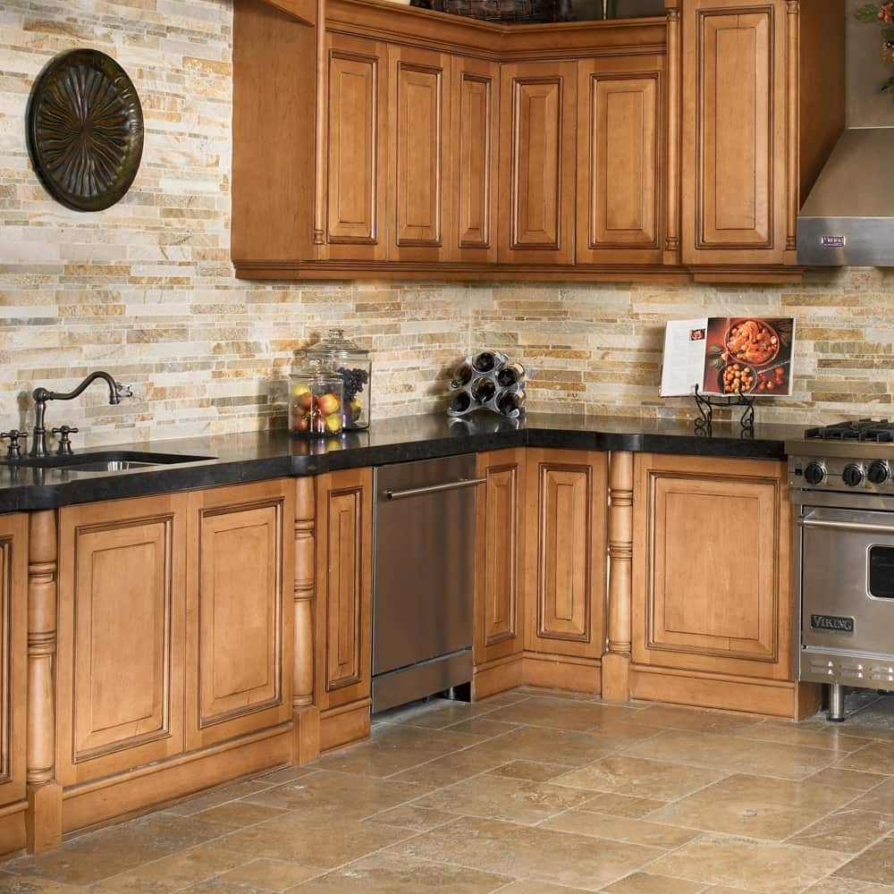 Travertine floors add a warm counterbalance to the Marron Cohiba granite counters. Photo credit: Arizona Tile