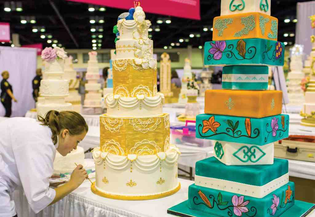 Pastry chefs and cake decorators put finishing touches on scene-stealing confections at The Americas Cake Fair. photo credit: The Americas Cake Fair