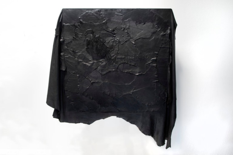 Darkness, salvaged and burnt leather, linen thread and L'Obscurite scented black wax on board (2015). Photo: Supplied Australian Design Centre