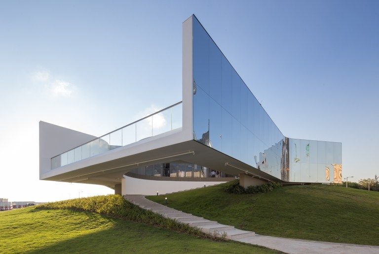 Cantilievering over the grass, M+ Pavilion Hong Kong. Image: Courtesy of West Kowloon Cultural District Authority and M+, Hong Kong
