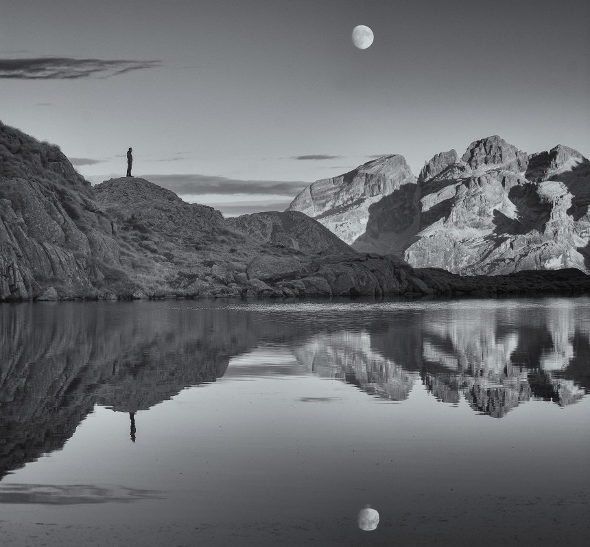 grayscale-photo-of-lake-and-mountains-4215070