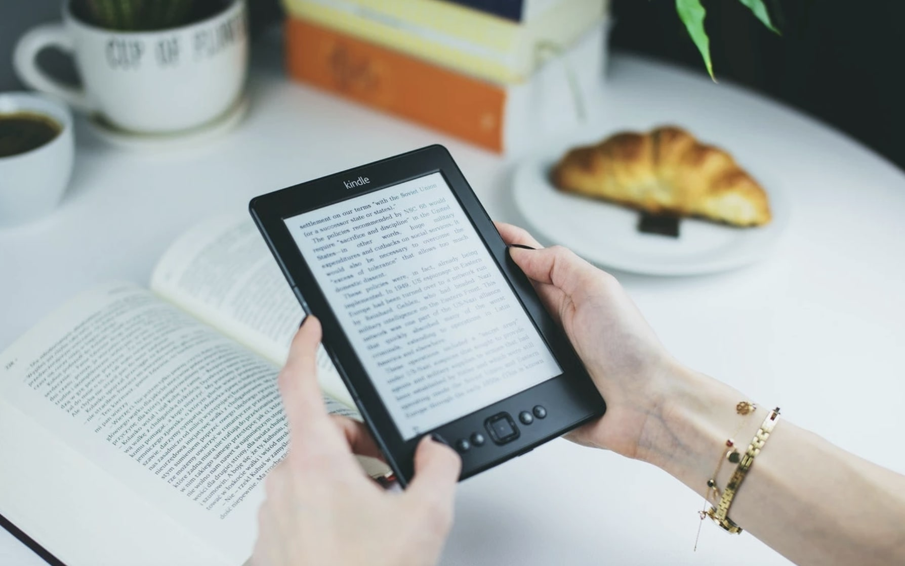 Woman using an E-Reader instead of a book