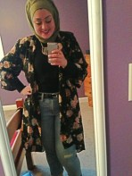 Boyfriend jeans and the long chiffon black floral cardigan complement each other well.