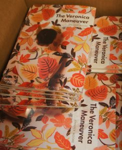 "Unboxed copies of ""The Veronica Maneuver"" in the UA Press offices at Quaker Square."