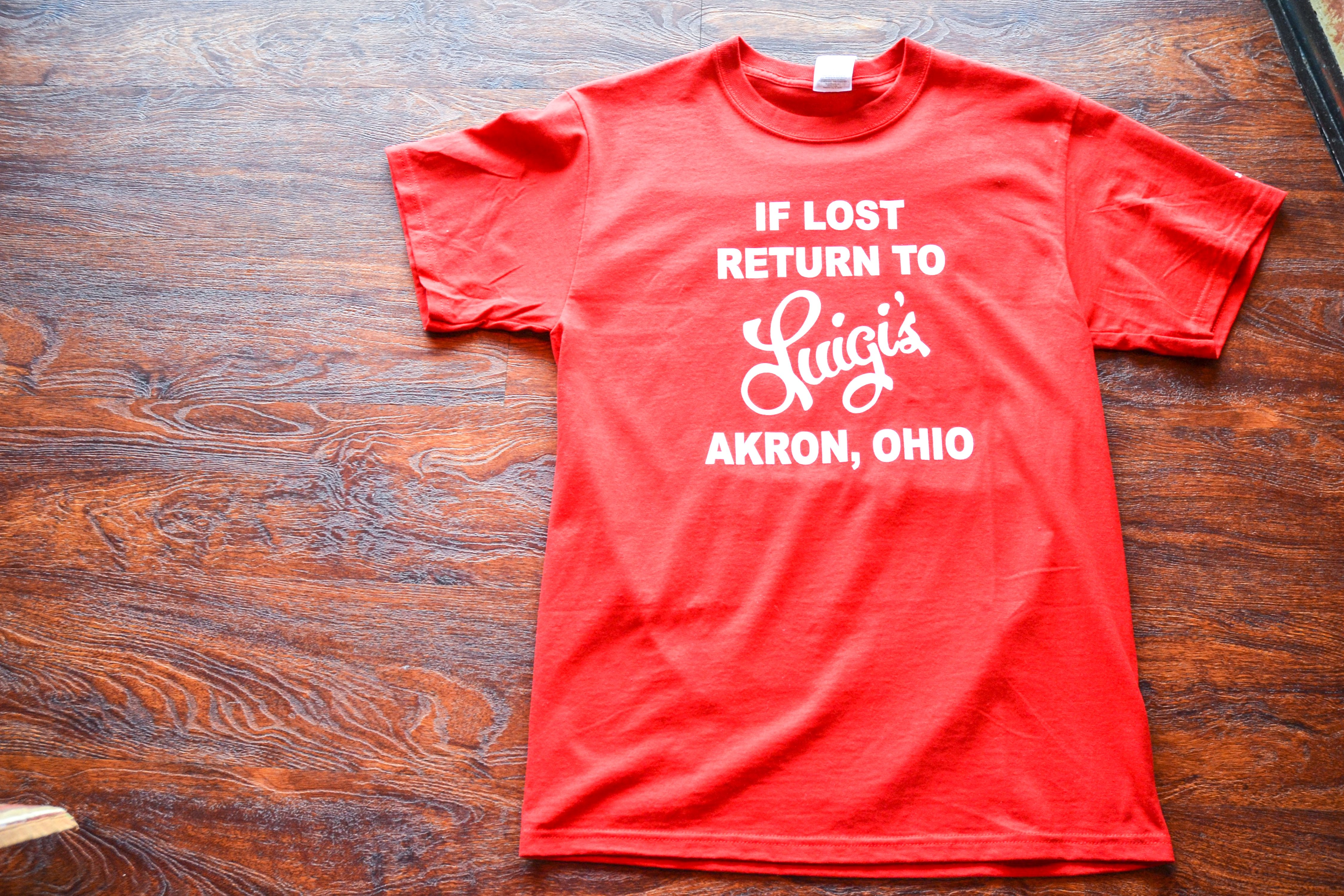 "e3ae7ce0357f9 Akron s most popular red sauce restaurant claims it s t shirt design goes  back to its 1950s origins. Try the vintage ""If Lost"" design or their  current ""Try ..."