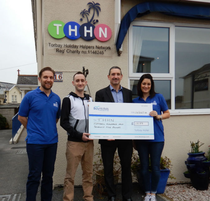 From left to right: Luke Tillen, founder and managing director of THHN, Aaron Hope of the Torbay Hotel, Simon Murray, manager of the Torbay Hotel, and Rebecca Davies, THHN business relations manager.