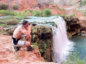 photographer shooting Navajo Falls, Havasupai