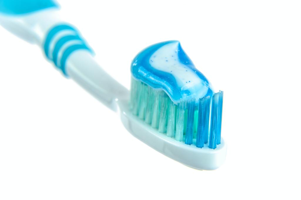 toothbrush with toothpaste on it