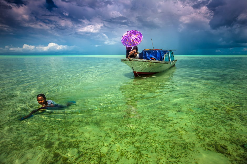 The Bajau look down at the fish.