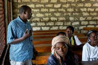 A Rocha staff member Henry Kigen speaks with the parents of the ASSETS.