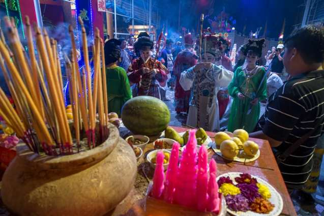 Offerings are laid out and now actors perform their religious rituals before the show.