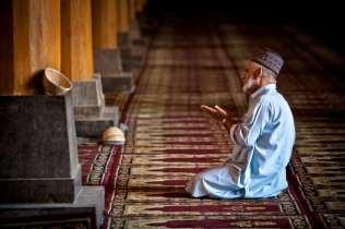 A man prays at the Jamma Masjid.