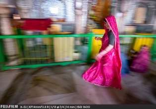 A women circling the alter in devotion.