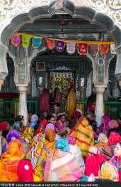 The woman of Radha Gopinath Krishna Temple singing devoitonal songs.