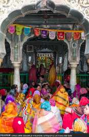 The woman of Radha Gopinath Krishna Temple singing devoitonal songs.
