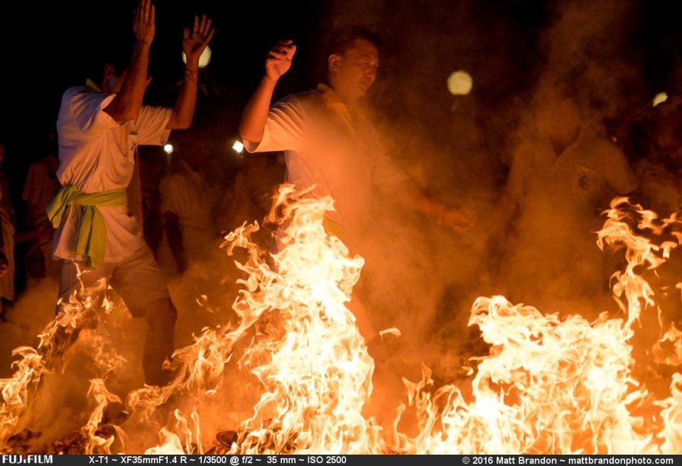 As if walking through hell, these devotees walk over burning coals and paper.