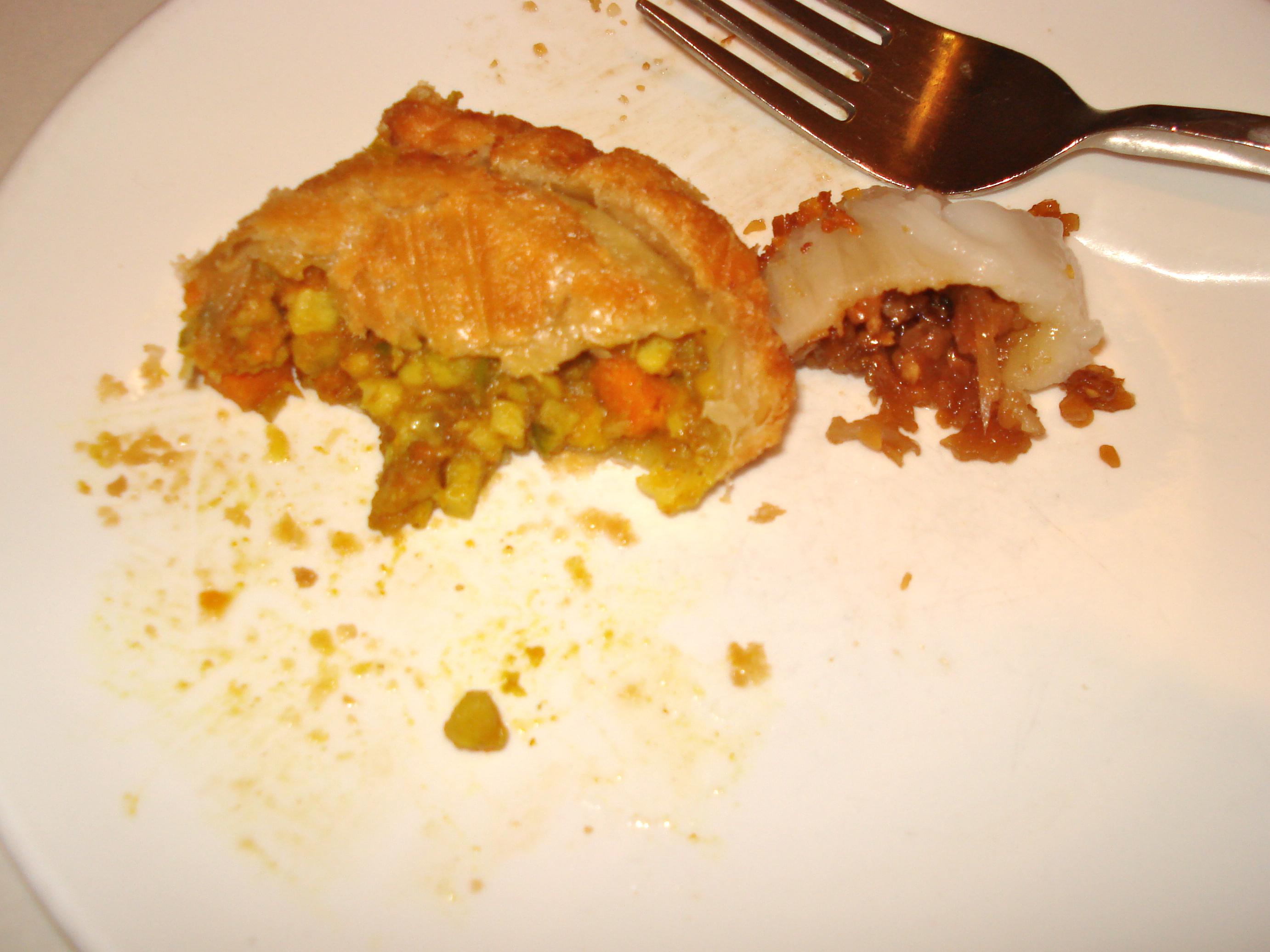 The inside of filled things: the curry puff had sweet potatoes and veggies and curry, the dumplings had minced veggies and peanuts.