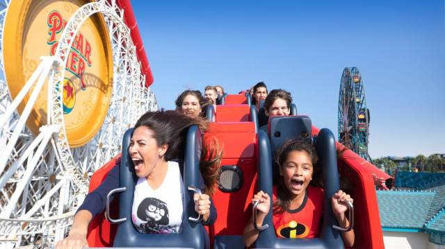 Guests enjoying themselves while riding on the Incredicoaster in Disney California Adventure.