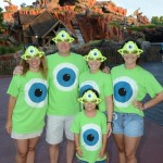 Disney Parks All-Nighter guests, otherwise known as NDM 130 & her family, show off their custom Mike Wazowski shirts May 24, 2013 as the sun rises over Splash Mountain at Magic Kingdom in Lake Buena Vista, Fla. (Todd Anderson, photographer)
