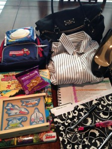 Packing essentials...notebook (check), heels (check), puzzles (check), board book (check).