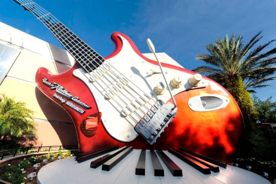 """ROCK ON!:  A 40-foot-tall electric guitar and giant keyboard adorn the exterior of the """"Rock 'n' Roller Coaster Starring Aerosmith.""""  The thrill attraction is an indoor roller coaster at Disney's Hollywood Studios theme park at Walt Disney World Resort in Lake Buena Vista, Fla.  Inside, riders board a limousine-themed roller coaster car and are launched from 0-60 mph in 2.8 seconds -- all while listening to a custom-recorded soundtrack by the legendary rock group Aerosmith. (Gene Duncan, photographer)"""