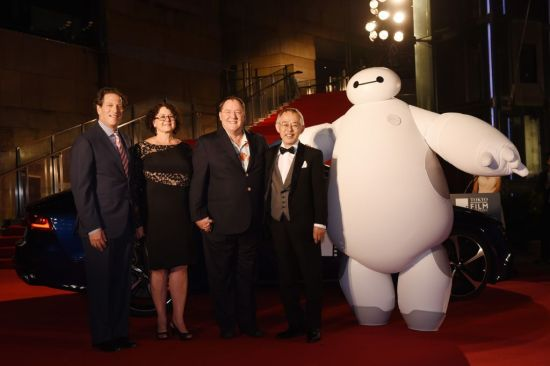 """General Manager of Walt Disney Animation Studios - Andrew Millstein, Nancy Lasseter, Chief Creative Officer of Walt Disney and Pixar Animation Studios - John Lasseter and Studio Ghibli producer Toshio Suzuki arrive at the """"Big Hero 6"""" Japan premiere during the 27th Tokyo International Film Festival at Roppongi Hills on October 23, 2014 in Tokyo, Japan.  (Photo by Atsushi Tomura/Getty Images for Disney)"""