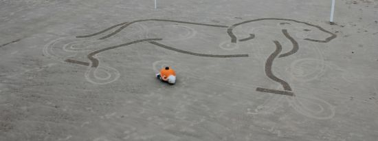 Disney's BeachBot drawing an animal. Maybe the Lion King? ;)