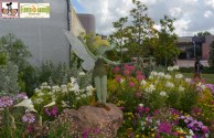 The Tinker Bell Topiary leads the way to Tinker Bells Butterfly Garden!
