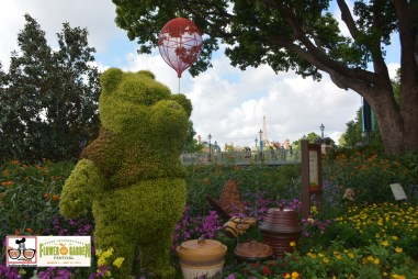 Winnie the Pooh and the Pollinator's Parade with France in the distance - Epcot International Flower and Garden Festival 2015