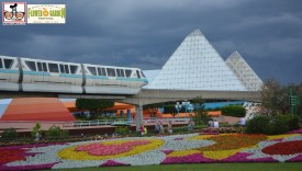 A Monorail passes over the Festival Blooms in front of the imagination pavilion.