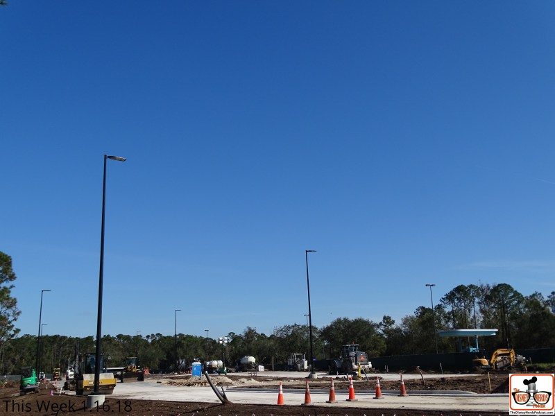 """The future of the park's new traffic exit lanes is """"bright"""". Workers installed brand new pole lights in the yet to open new vehicle lanes near the main entrance."""