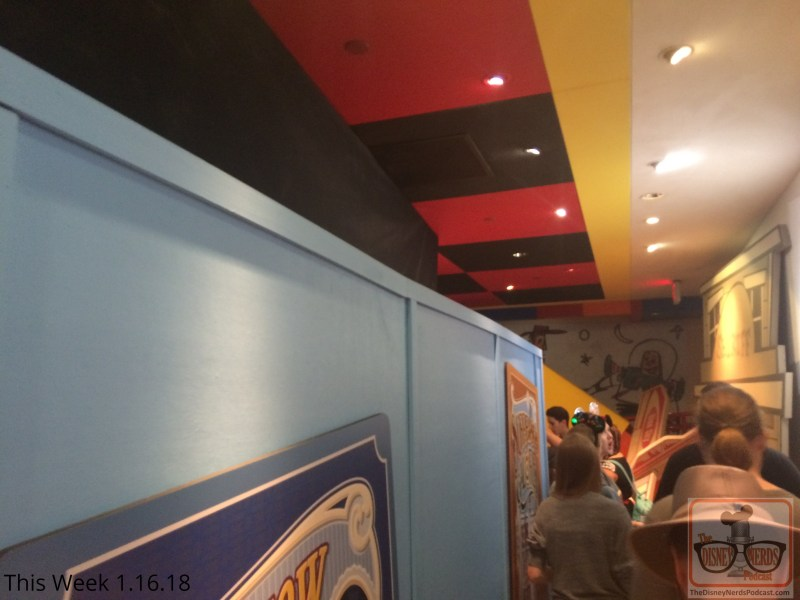 News flash from Pixar Place! The main que room of Toy Story Midway Mania is now behind construction walls. Attraction riders now enter both stand by and fastpass ques outside but then gradually merge together through the emergency exit. Grab those yellow 3-D glasses and rack up some points on this attraction.