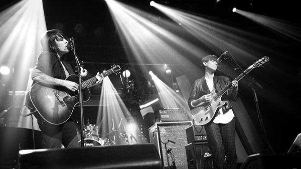 Tegan and Sara performing onstage
