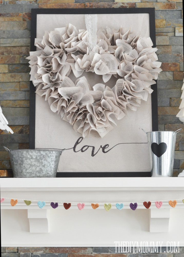 DIY Neutral Valentine's Day Mantel Decor Ideas via The DIY Mommy - Book Pages Heart Shaped Wreath DIY Tutorial, Crocheted Heart Garland and DIY Coffee filter trees!