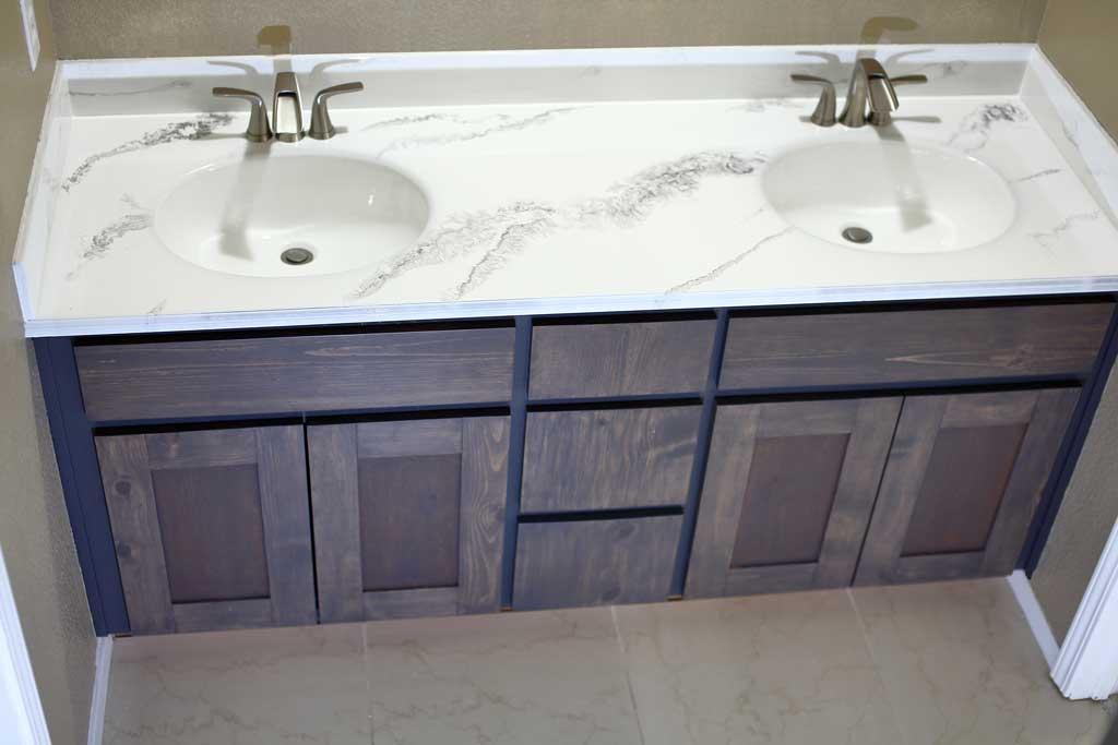 how to refinish bathroom vanity top