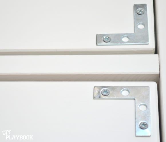 silver corner brackets