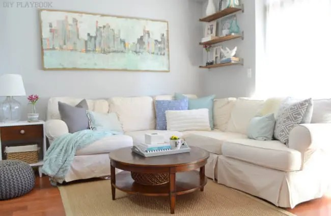 throw pillows for living room couch rugs ideas how to style on your the diy playbook i love my white sectional with blue and gray