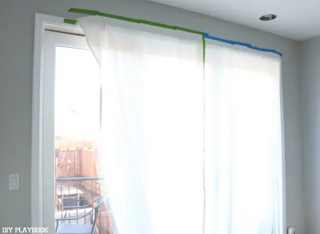curtain with tape on windows progress