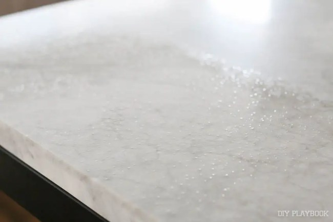 marble-table-seal-wet