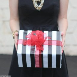 2016-DIY-Playbook-Christmas-Card-wrapped-gifts-stripes-red-bow