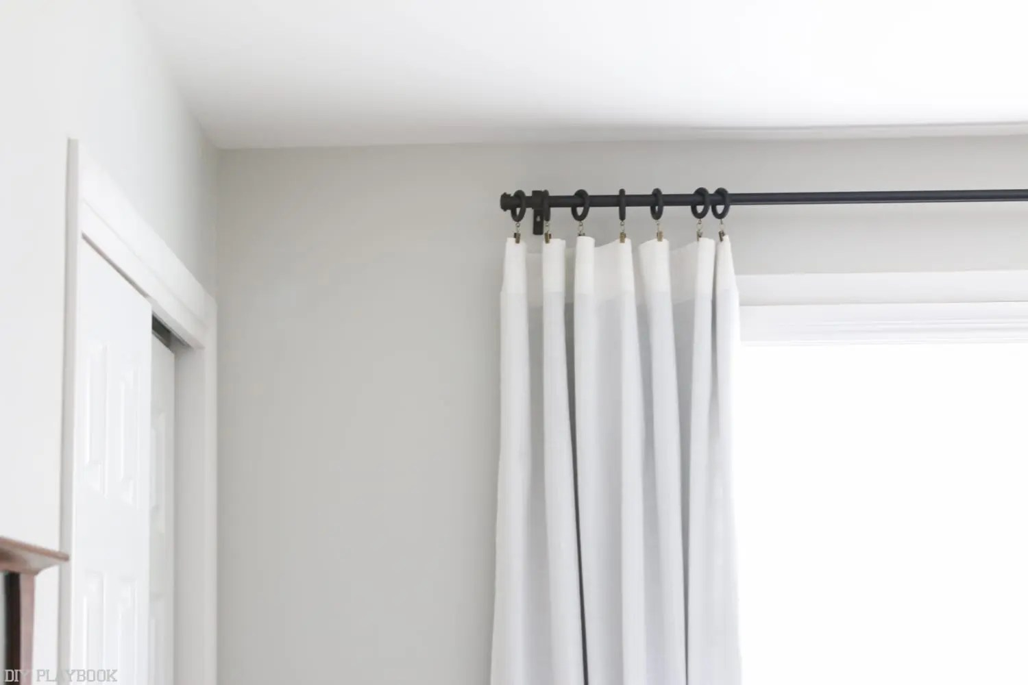 how to hang curtains to transform your