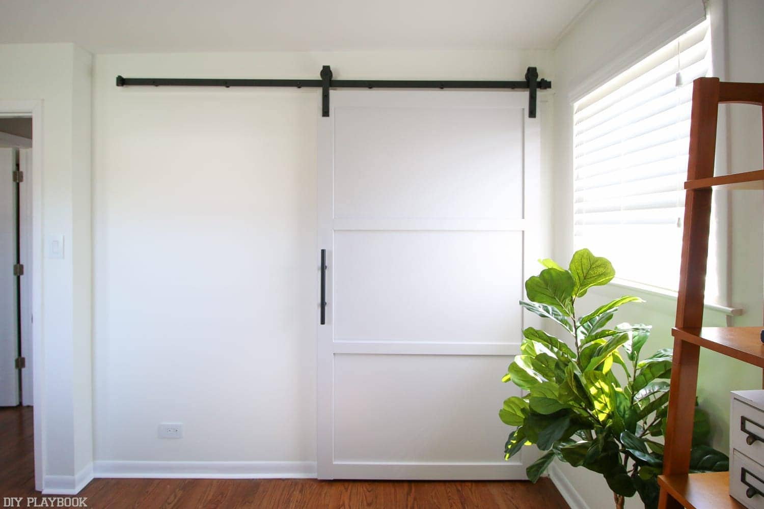 How to Hang a Barn Door in your Home DIY