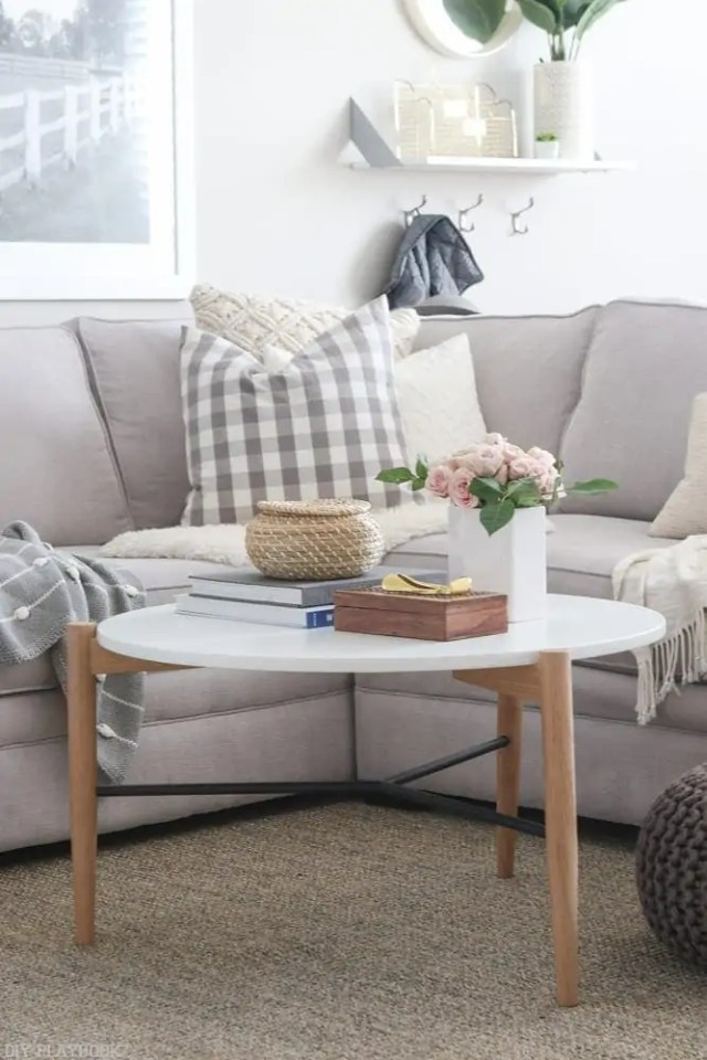 round_modern_coffee_table-flowers_pillows