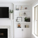White Built Ins Around The Fireplace Before And After The Diy Playbook