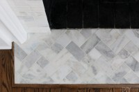 A White Marble Tile Fireplace Update | The DIY Playbook